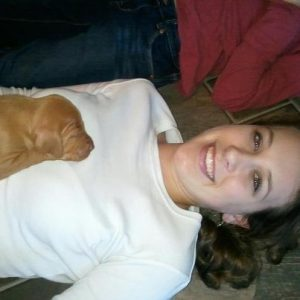 Lindsey (our daughter) enjoying vizsla puppies